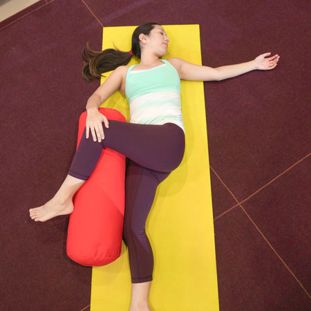 spinal twist yoga bolster